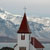image of church, sea and mountains