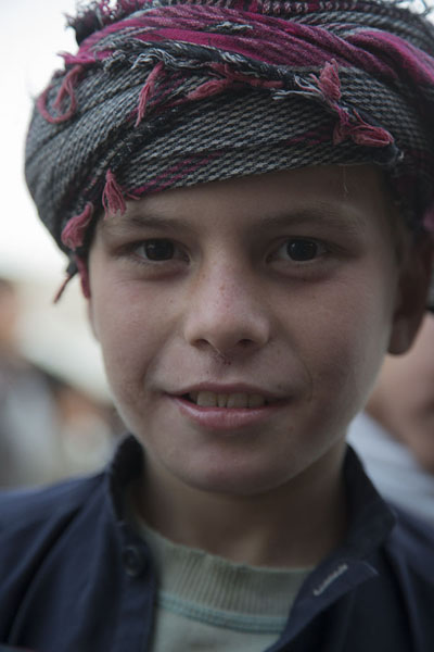 Picture of Afghani people (Afghanistan): Boy posing for a picture at the market of Mazar-e-Sharif