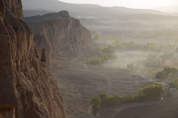 View over the rockface with the caves and Small Buddha niche | Bamiyan Buddhas | Afghanistan