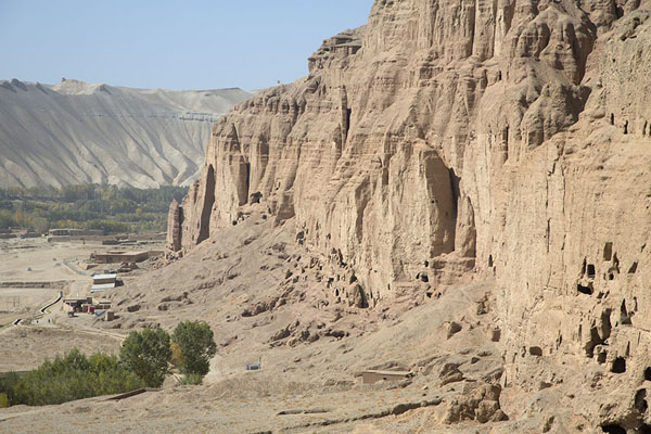 Looking at the cliffs with Buddha caves and the Great Buddha cave at the far end | Bamiyan Buddhas | Afghanistan