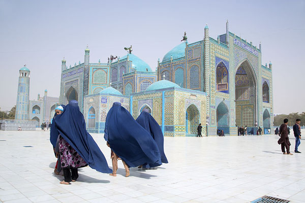 Three women in burqa walking near the Blue Mosque | Hazrat Ali Shrine | Afghanistan
