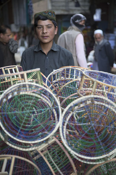 Boy with wheelbarrow full of empty cages at the bird market | Ka Faroshi Market | Afghanistan