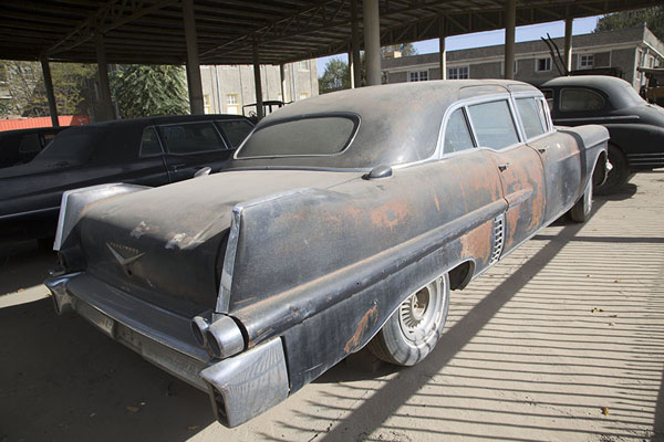 Picture of Kabul Museum (Afghanistan): Cadillac Fleetwood car under dust outside Kabul Museum