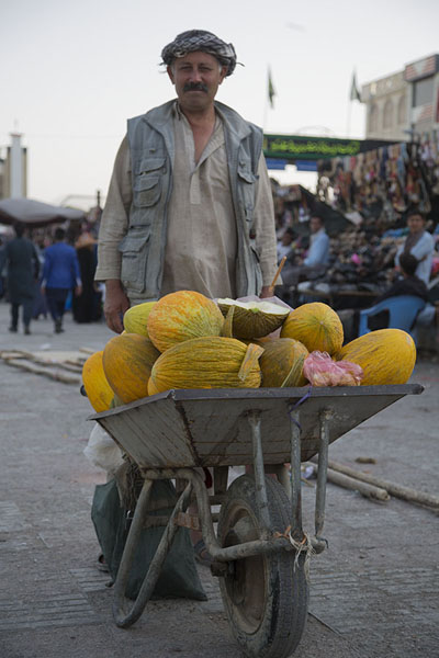 Picture of Man with wheelbarrow full of melons in the streets of Mazar-e-Sharif