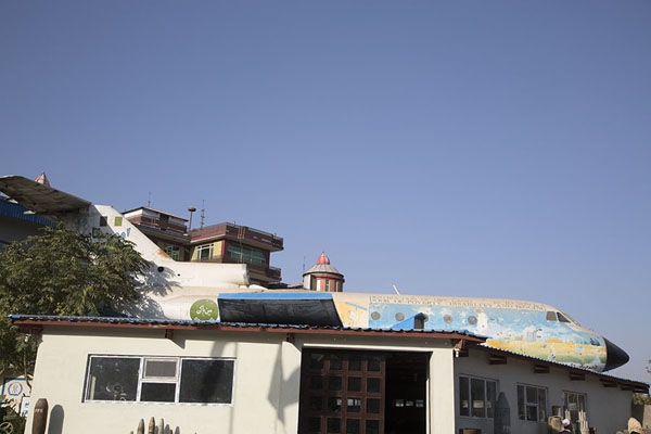 Picture of The Soviet Yak aircraft tops the building of the museum, acting as a classroom for schoolkidsKabul - Afghanistan