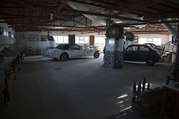 The interior of the museum with classic cars and the landing gear of the integrated Yak aircraft | OMAR mine museum | Afghanistan