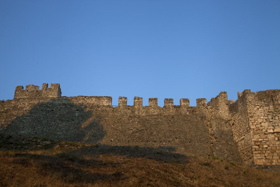 The crenellated wall of the citadel of Berat in the early morning | Berat Citadel | Albania