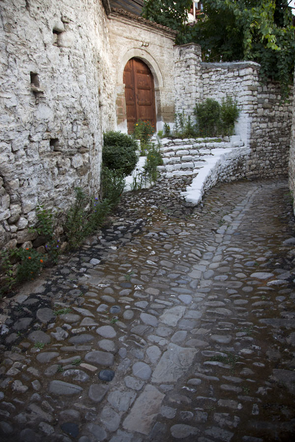 Cobble-stone street with stairs and walls in Mangalem | Mangalem | Albania