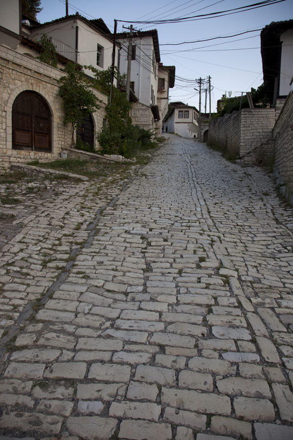 The main street of Mangalem lined by typical houses | Mangalem | Albania