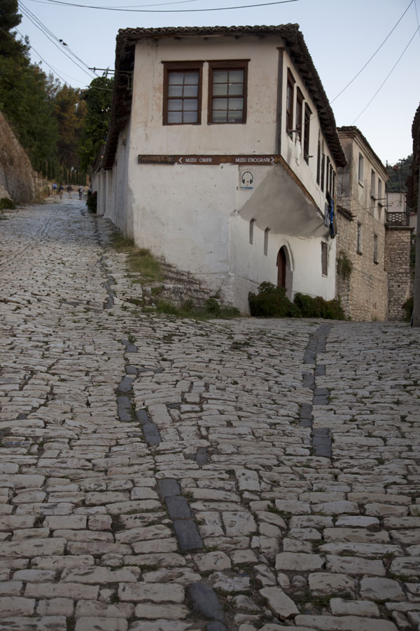 Picture of Mangalem (Albania): Cobble-stone street with typical house common in Mangalem
