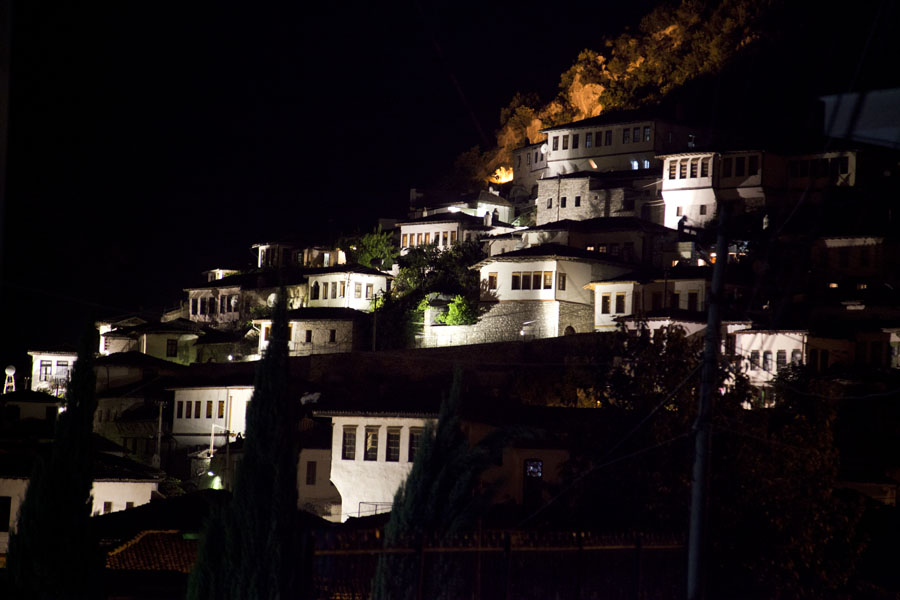 White houses built against the hill of Mangalem at night | Mangalem | Albania