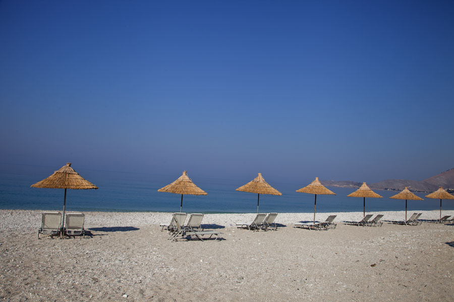 Parasols on the beach once full of bunkers | Borsh bunkers | Albania