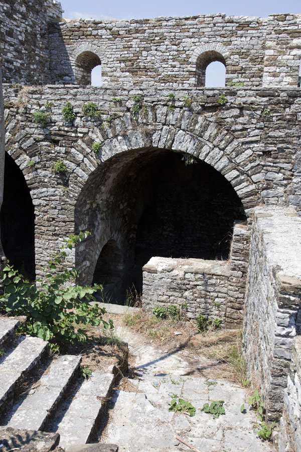 Picture of Gjirokastër Castle (Albania): Looking into the wall of the castle where market stalls were once functioning