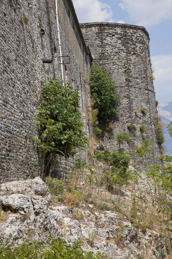 Picture of Gjirokastër Castle (Albania): Stone walls rising high from the rocky hill on which the castle is built
