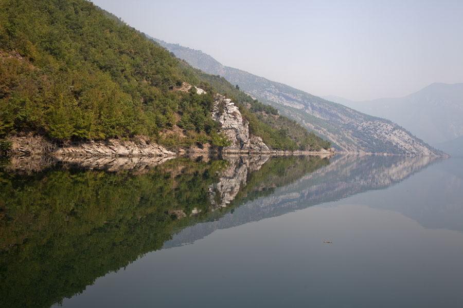 Picture of Mountains of Lake Koman perfectly mirrored in the waterKoman - Albania