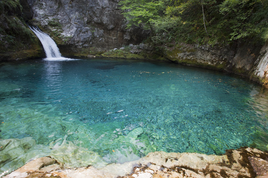 Picture of The Blue Eye Pool with small waterfall and totally transparent waterTheth - Albania