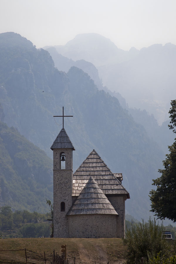 Picture of Mountains south of Theth rising high above the village church