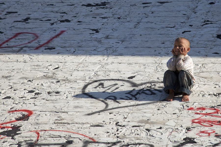 Picture of Boy wondering what to do next on the slope of the pyramid - Albania - Europe