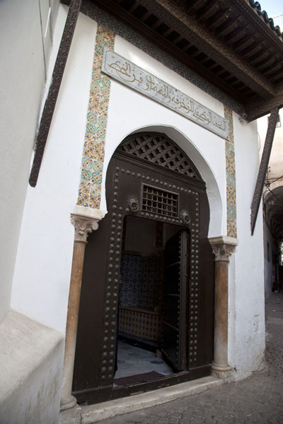 A richly decorated cedar wood canopy over the entrance of Dar Mustapha Pasha | Algiers Casbah | Algeria