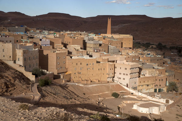 View of the old town of El Atteuf, with minaret, houses, and the mosque of Sidi Brahim at the bottom of the hill | El Atteuf | Algeria
