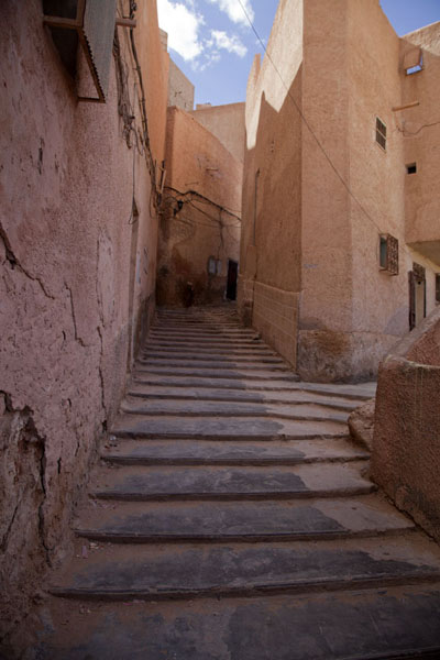 Stairs lead up an alley to the top of the hill on which El Atteuf is built | El Atteuf | Algeria
