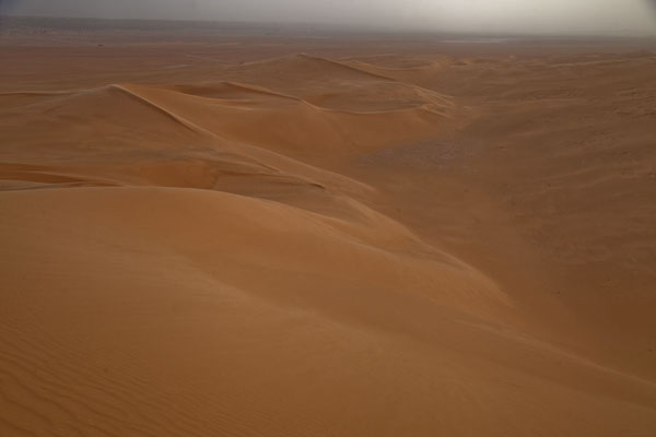 Looking down the sand dunes of the Sahara | Sebkha Circuit | Algeria