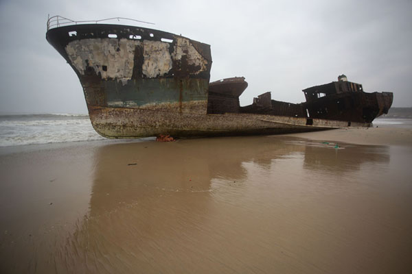Foto van One of the shipwrecks lying on the beachCacuaco - Angola