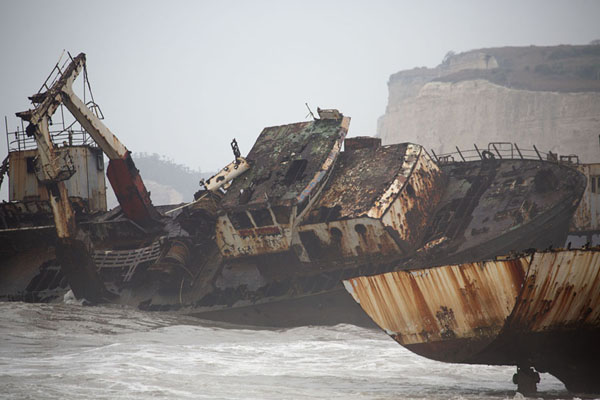 Foto van Two ships in the surf of the beachCacuaco - Angola