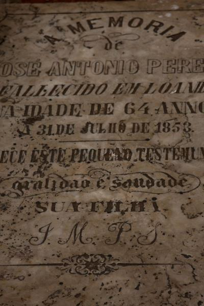 Old tombstone with calligraphic memorial for the deceased at the cemetery of Alto das Cruzes | Alto das Cruzes cemetery | Angola