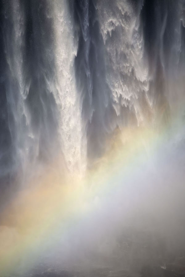 Foto van Rainbow across the lower Kalandula FallsKalandula - Angola