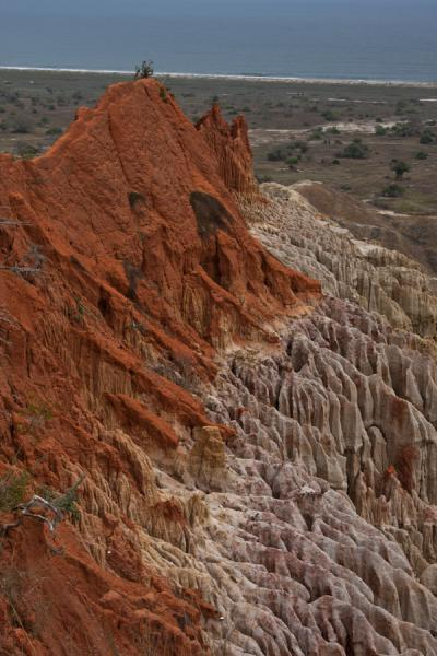 Narrow hill protruding from the wall of the canyon-like landscape | Miradouro da Lua | Angola