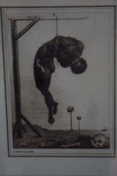Picture of Drawing of a slave hung alive in the museum of slaveryMorro da Cruz - Angola