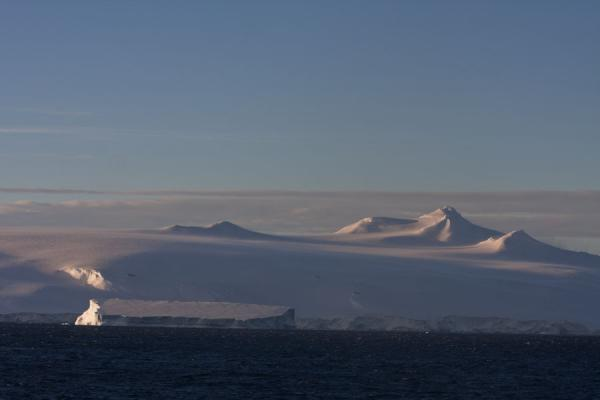 Late evening light on the mountains and icebergs of the Antarctic Sound | Antarctic Sound | Antarctica