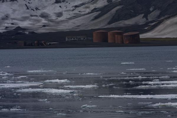 Picture of Deception Island (Antarctica): Ice floes and ruins of whaling station of Deception Island in the background