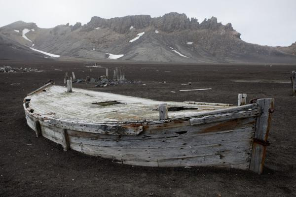 Picture of Deception Island (Antarctica): Grounded small boat at Deception Island