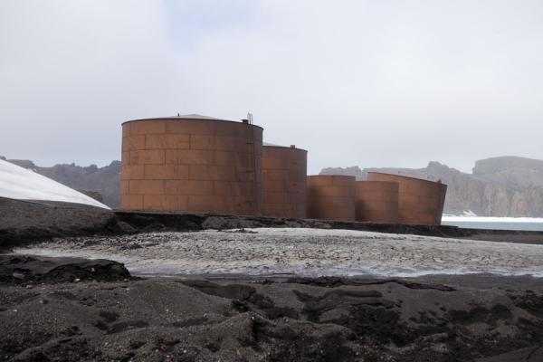 Old rusty tanks are remainders of the whaling station of Deception Island | Deception Island | Antartide