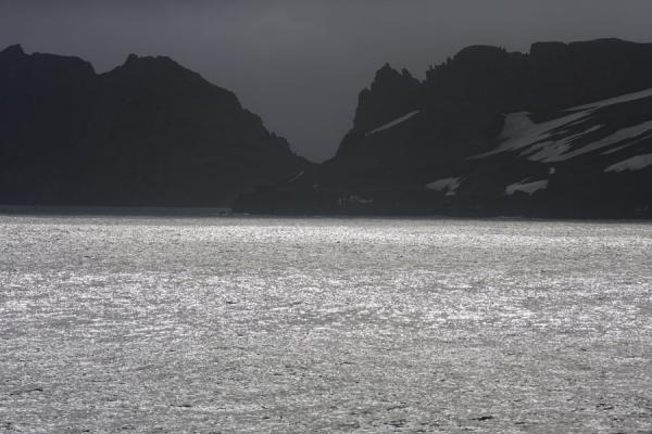 Picture of Deception Island (Antarctica): Looking at Deception Island from a distance with Neptune Window