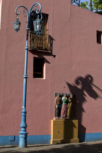 Picture of Caminito (Argentina): Shadow of lantern on a pink wall in Caminito