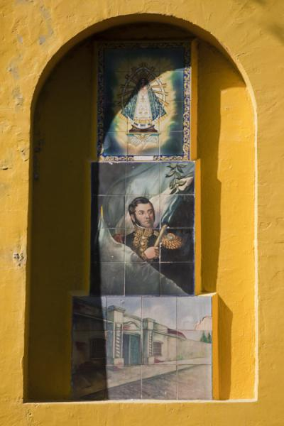 Picture of Caminito (Argentina): Yellow wall with paintings on display in Caminito