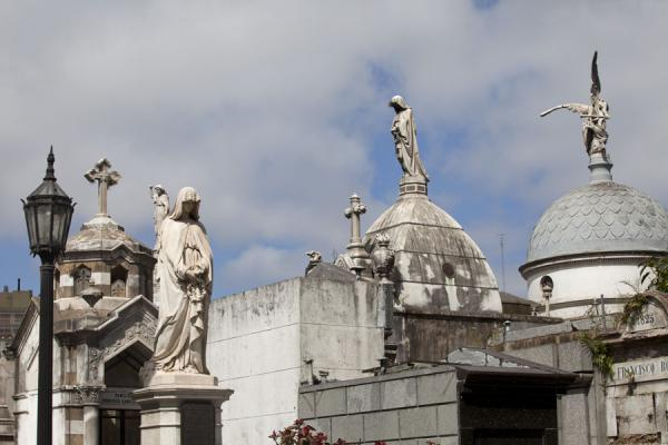 Some of the cupolas and statues on mausoleums in La Recoleta cemetery | La Recoleta Cemetery | Argentina