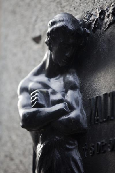 Picture of La Recoleta Cemetery (Argentina): Sculpture on mausoleum wall in La Recoleta