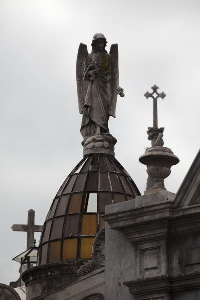 Picture of La Recoleta Cemetery (Argentina): Angel on cupola surrounded by crosses on tombs in La Recoleta