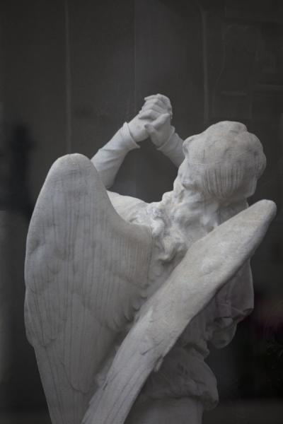 Picture of La Recoleta Cemetery (Argentina): Angel praying at a mausoleum in La Recoleta