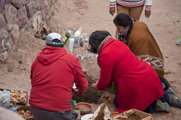 Picture of Women offering food and drinks to Pachamama in MaimaráQuebrada de Humahuaca - Argentina