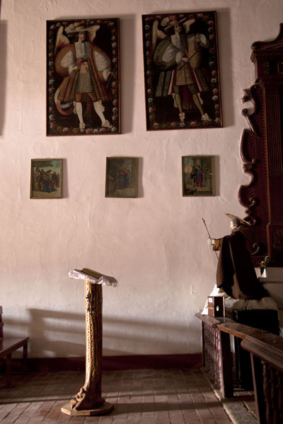 Some of the paintings of armed angels and the cactus furniture of the church of Uquía | Quebrada de Humahuaca | Argentina
