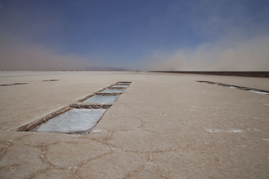 Basins of water for salt extraction and dust pushed through the air by the storm | Salinas Grandes | Argentinië