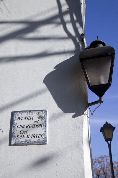 Picture of Lantern and street sign of the very long Avenida del Libertador San Martín in San Isidro