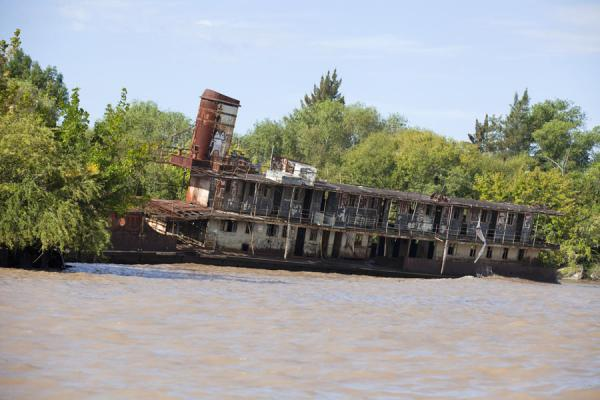 Old shipwreck rusting away on the Luján river near Tigre | Tigre Paraná Delta | Argentina