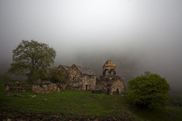 The Monastery of St. John surrounded by trees in the fog | Ardvi | Armenia