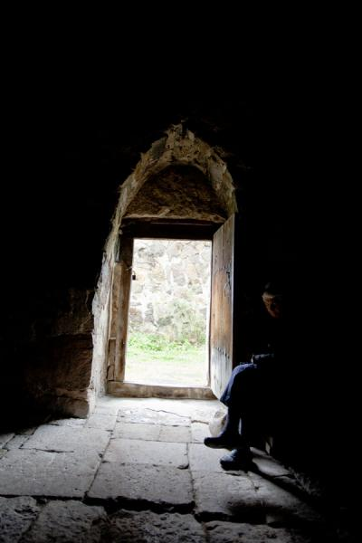 Old female caretaker at the door of the Monastery of St. John | Ardvi | Armenia